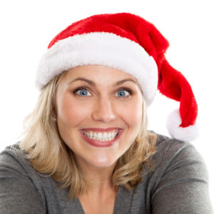 Happy woman wearing santa hat